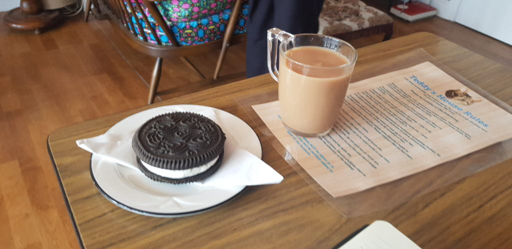 Cup of tea and giant Oreo biscuit at the cat cafe